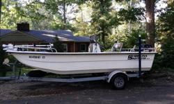 2008 Carolina Skiff 198DLX (flat bottom skiff), 2008 Suzuki 90DF 4-stroke (approx. 350 hours), MinnKota Riptide 24-volt 80-pound thrust trolling motor (1 year old) with remote control, foot pedal and quick release mount, on-board 2-bank 20 amp charger,