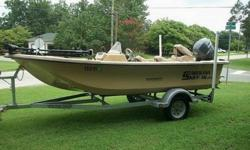The boat is 16 foot long with a single side console driver cockpit. It is a doe skin color. It has a 50 HP four stroke Yamaha motor. It has 3 seats with 2 fishing pedistals for the front and back fishing seats. It has a Minn Kota Edge 45 pound foot