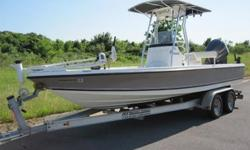This is a Very Very nice boat, and is equipped with a T-Top Tower to keep you out of the sun! This gorgeous boat has a Aluminum dual axle trailer. The engine fires right up and sounds great. The interior is in great shape, and this center console has room