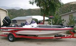 """This boat is 20 ft. 4 in. long and has a 93"""" beam. It has a 200 Mercury Optimas Motor, Dual Console, 24 volt 82 lb. thrust Motorguide trolling motor, Lowrance X86 Graph, Hydraulic Steering, Guest 3-bank onboard charger, 48 gallon fuel tank, single axle"""