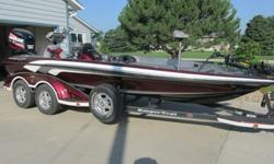 """Equipped with an 250 HP Evinrude E-tec motor. The boat has been used very little and has always been kept in a garage. Comes complete with Raker II, 8"""" manual jack plate, Minnkota 101#, Lowrance 28C, 520 at bow, Hamby's, hot foot, and livewell pumpout ."""