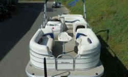 SUPER CLEAN 2008 SUN TRACKER 21 PARTY BARGE SIGNATURE WITH ONLY 186 HOURS AND MERCURY PRODUCT PROTECTION WARRANTY! A 60 hp Mercury 4-stroke EFI Bigfoot outboard with power trim powers this pontoon package. Features include: color coordinated bimini top,