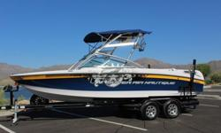 "Family water sports boat with all of your ""must haves"" in a wake/surf boat. Large wakeboard boat with 14 person capacity, wrap around seating, open bow, filler pad for front and back sun deck is ready for your friends and family. Boat stored under"