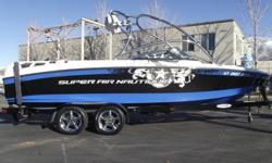 This 2008 black and blue Super Air Nautique 230 Team Edition is nicely loaded for a great day/week on the water. Some of the great features are- Tower, tower mirror, upgraded plug and play ballast system, reversible/removable center bench, port/stbd lean
