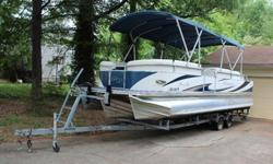,,,,,,,,,2009 Manitou Osprey Pro Tri Hull V-Toon SHP250HP Evninrude E-Tec Engine with only 42.6 hours. Can easily hit 49MPH on the water.Ski Tow BarDouble Bimi top with enclosure.Storage in center tubeOn boat changing room (pop up and surround for