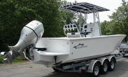 """SUPER NICE 2009 OCEAN WAVES SEA HAWK 27/CC FISHING BOAT. IT IS 27' LONG WITH AN 8' 2"""" BEAM. THE ENGINE IS A 225HP FUEL INJECTED, FOUR STROKE HONDA V6. THIS BOAT IS ABSOLUTELY LIKE NEW AND READY TO GO. IT ONLY HAS 27 HOURS ON IT AND HAS THE REMAINDER OF"""