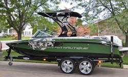 2009 Super Air Nautique 210 Team Edition is looking good on and off the water. Loaded with almost every options Nautique offered in 2009. Tower, 2 sets of speakers, swivel combo racks, bimini, snap covers, ballast, zero off cruise control, theater