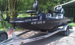 This boat is a great buy for someone. It hasn't been in the water 20 times since original purchase. It has a 50hp Yahama outboard engine, Charcoal Metallic Paint & Gray Carpet, Fiberglass Console with tinted shield, Black Sterling Tach, Fuel & Speed