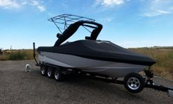 2010 Malibu Wakesetter 247lsv in excellent condition. Only 133 hours. Runs and drives like new. White, moon beam and black iris colors. Custom extended bimini plus factory bimini = lots of shade. Indmar LS7 505 horse power - closed cooling, Mali-view,