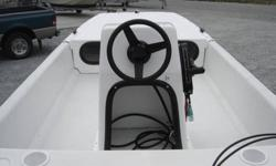 BRAND NEW 2010 J14 CAROLINA SKIFF WITH CENTER CONSOLE, LONG FRONT DECK, BENCH SEAT, RUNNING LIGHTS, BILGE PUMP 6 GALLON FUEL TANK, BATTERY AND GREAT RUNNING 2005 MERCURY 15HP FOUR STROKE ENGINE WITH ELECTRIC START WITH LESS THAN 50 HOURS. THE TRAILER IS A