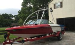 This is a 2010, garage-kept, custom-built boat from Malibu. Exterior and interior colors are all custom one-off production. The boat's trim is all chrome and stainless steel. The monsoon engine is high output from the factory and easily pulls footing