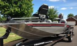 2010 Bass Tracker equipped with Mercury 50HP outboard motor and factory matching trailer. This boat is in exceptional condition and is completely lake ready. The carpet, seats, and all storage compartments are in like new condition. The exterior of the