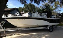 2011 200 XT Seafox with a 2011 115 Yamaha outboard. Boat has Seafox lifetime home warranty, solid wood construction black Bimini top 80 pound thrust trolling motor AM/FM stereo with CD player, comes with single axle aluminum sports trail trailer. Aerated