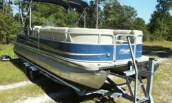 2011 Bentley 240 Cruise Encore SE Pontoon. She is powered by Mercury 60HP 4 stroke outboard that runs and operates perfectly. It is also known as a 60 bigfoot. It moves this pontoon to around 20mph. This boat is really a party barge with room for an