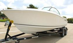 2011 Nautic Star 2000 DC Dual Console is located in Dallas Texas. In stock ready to deliver Trailer included. This full sized off shore Dual Console is ready for fishing and family fun. Full bow cushions and rear seating. 20 Gallon Livewell and rod
