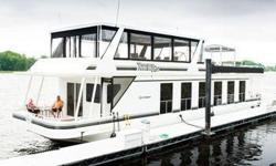 WOW, here is your boat, like new and a home on the water. Fantastic interior with cherry wood cabinetry, with 4 bedrooms, one is a king size the other three are queen, three heads with separate showers and heated floors, full galley with stainless steel