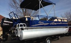 2012 Bentley 20ft Pontoon Boat equipped with a 2013 Mercury 90HP outboard motor and 2012 pontoon trailer. Bentley is a top quality brand in pontoon boats and this pontoon is in pristine condition. This pontoon has great colors and a wide open floor plan.