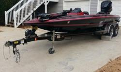 This beautiful red and black Bullet 21 SS high performance bass boat with Yamaha 250 SHO power will stop traffic on the parkway and spin heads around on the water. The brilliant red and black finish, the design, the mechanics, the electronics, the 4.2 L