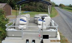 Boat is in almost new condition.Motor has 39 hrs. on it, was broken in properly,and runs and looks like new and has warranty till April 2015.The trailer looks almost new and has less than 300 miles on the road.1]built in 12 gallon fuel tank 2]Sony