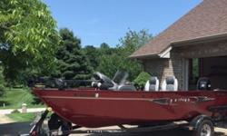 ,.,.,.Mercury 60 Hp ELPT with ONLY 26 ACTUAL HOURSShorelander trailer with spare tire, fold back tongue, boat float guidesLund mooring cover Helm seat slider, night running lights, interior lightMinnKota po/55 trolling motorLowrance X-4 fish finder Bass