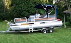 Trailer with surge brakes included . Excellent tires. Will sleep four people when the full camping enclosure is up. Will seat a crowd when fishing or playing on the water. Has a ski/tube tow bar with attached boarding ladder. All aluminum floor decking.