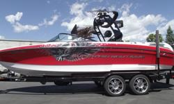 Can you say loaded!!! This 2012 Super Air Nautique 230 Team has almost all the factory options and then some. 2 sets of tower speakers with sox, combo wake board racks with sox, 8 tower lights and bimini. And that's just the tower. Heater, lean backs,