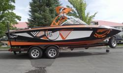 This orange and black 2012 Tige RZ2 is a head turner. This Tige looks good on and off the water. Nicely loaded for a great day/week on the water. Some of the awesome options are the wet sound tower speakers/stereo system, transom stereo controller, plug &