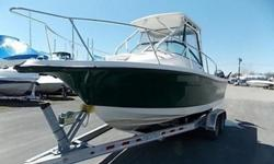2012 Trophy Sportfishing Boats 2102 Walkaround.Clean, 1 owner boat, fresh water only. Mercury 150 EFI 4 stroke, cushion package, port a poty, trim tabs, compass, VHF radio pkg, Lowrance HDS 5 GPS, extended hardtop w/ rocket launchers and enclosure, a