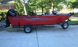 Beautiful red fishing boat w/ Front & Rear Aerated Livewells and loaded with the finest equipment. Optional equipment above base priced unit includes 90HP 4 stroke Mercury with only 75 hrs. and still under warranty, Stainless Steel Prop, Minn Kota Maxxum