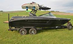 The Super Air Nautique 210 is all-new for 2014 with an innovative design that will pull you in and reignite the following that started it all. The new 210 is sure to please the Nautique traditionalist while inspiring excitement at the discovery of new