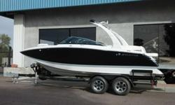 Make a statement - without making an effort. Conversation flows easily in the living room-like cockpit of this 24-foot sport boat, and the socializing can continue indefinitely in the inviting transom seating area with stereo speakers. This boat has the