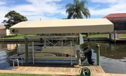 """Immaculately kept Pontoon with 6 year extended warranty on Mercury 60HP Bigfoot thru 2020. Runs perfectly 380 hours Stainless Cleats 25"""" Pontoons Vinyl Deck Livewell Package Sony CDXM20 w 4 Speakers Changing Room Canopy This Boat Never Sat in the water."""