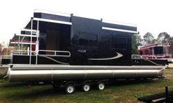 This is a new beautiful Grand Island 32 ft house boat we are listing below cost. It has two tubes.It is a new house boat and has never been used. This pontoon boat is 32 ft long with two pontoons and 8 ft wide. It is close to 12 ft tall sitting on the