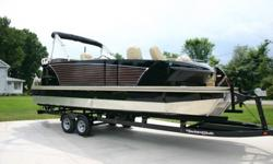 2014 Demonstrator model with only 5 hours running time and it is loaded with all the great features at a super low price. The Larson Escape has the cutting edge Triple tapered v bottom pontoons for better speed and performance. This is a package including