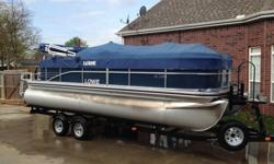 This unit was used twice and is in like new condition. This unit comes with the trailer as shown in the pictures.The SS 210 pontoon boat is the complete pontoon package, featuring premium amenities and lasting durability at an extraordinary value. Every