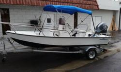 This boat is a 15? center console type with a built in livewell positioned perfectly for smooth riding and quick planning. The 40hp motor brings it up to plane in seconds even fully loaded. Power tilt and trim. You can hardly hear the motor when cruising.