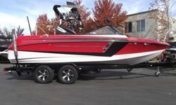 This Super Air Nautique 210 in nicely loaded for a great day/week on the water. Some of the cool features are tower speakers, bimini, NSS (Nautique Surf System), theater seating, GPS helm package, docking lights, underwater lights, level II stereo