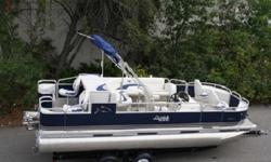 Construction & Appearance Rough Water Package - (Waveglider only) .110 material/added bracing/solid welds Two tone color walls Platinum Package (SST gas cap & vent, polished deck corners, SST cup holders) High flex 3D bold chrome Tahoe logos Bolted deck