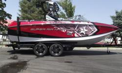 This 2015 red metal flake and black Super Air Nautique G23 is turning heads on and off the water. Nicely loaded with almost every option Nautique offered in 2015. Some of the cool options are the tower speakers, bimini with surf pockets, cinch cover, bow