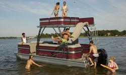 """2015 Premier Sunsation 240 Upper Deck TritoonSpecificationsOverall Length 24' 5"""" Deck Length 23'Width 8' 6"""" Weight (3 tubes/36"""" PTX)* 2750 lbs.Ma. Weight Cap. (3 tubes) 3000 lbs.Max. Weight Cap. (36"""" PTX) 3600 lbs.Person Cap. (2/3/36"""" PTX) 12/15/18Tube"""