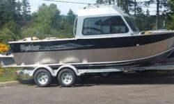 """2015 Raider 202 HardTop.2015 Raider Wide Bottom, High Side, Hard Top.Welded Bow.Fish Box In Bow and In Transom.72"""" Bottom.36"""" Sides.Drop Curtain.Extra Seating.Anchor Storage.OffShore Bracket.Yamaha 115Hp 4 Stroke Engine.EzLoader Galvanized Tandem Axle"""