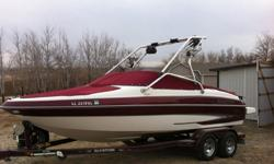 Clean and in great condition! 21.5 Feet in Length, Always Garaged. Wakeboard tower with Speakers, Custom matching easy load trailer with swing-away tounge, am/fm cd stereo, Spare tire. Sport Interior. Open Bow. 2 large storage areas on each side of