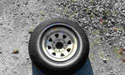 7.00-15LT Trailer tire and six lug white wide spoke wheel. From 1984 EZ Loader boat trailer. Some checkering, especially the white wall. Holds air perfectly. Tread is nearly 100%. It'd make a great spare. Call or text 993-3937 with a 262 area codeListing
