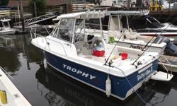 This well maintained 2007 model 2052 is powered by a Merc diesel (3.0 gal per hr), it has a hard top, fish finder, AM/FM/CD player, dual batteries, GPS, swim step, RW wash down and a porta potti. Also included; rod holder outriggers, anchor ball, net,