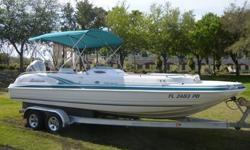 2003 Hurricane GS 232 Fun Deck, This is the ultimate in deck boats, comes with a Honda 4 Stroke 225 hp premium Engine, Sink with 12 gallon fresh water tank. 12 person capacity, double axle aluminum magic tilt trailer,Changing room, cd player, docking