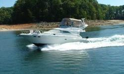 2002 Sea Ray 40 SEDAN BRIDGE World class cruising in an elegant sedan bridge. Lavish interior with high gloss cabinetry boasts two heads and 2 staterooms with bulkhead compartment doors, electrically convertible salon sleeper/sofa, huge galley with large