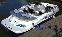 Sporty Mediterranean Blue 2006 Sea Doo 200 Speedster Jet Boat and matching Karavan Trailer. This 20 footer is powered by Twin Rotax 215 HP (430 hp total), supercharged intercooled jet drive motors. Mint condition, meticulously maintained, only 140 hours.