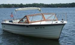 * A wonderful 26' all wood classic day cruiser accommodates 8-10 adults on one level - great for entertaining! * Private cuddy up front, with plenty of room for two to relax or take a snooze. * Has a porta-potty below deck. * Powered by a 260HP V-8