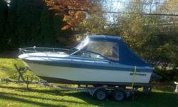 You can own this classic 22' Cruisers Inc. Baron. This classically styled vessel features a teak swim platform with ladder and more teak accents all around. Its not one of those modern boats that has all the nautical feel of a pre-fab Home Depot stall