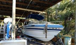 22 foot 330 HP 7.4 litre Mercruiser w/New Bravo 1 outdrive, A Barn find with only 70 hours ORIGINAL HOURS !. Sounds like a cigarette boat , started on third bump, new hydraulics and Stainless Steel Exhaust , Magnum Transom assembly, and Bravo 1 replaced